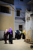Veiled women walking through a city street Royalty Free Stock Photography