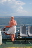 Veiled young woman on deck of ferry Royalty Free Stock Photos
