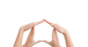 Veiligheid!! vrouwelijke handen die in vorm van een huis worden gehouden Royalty-vrije Stock Afbeeldingen