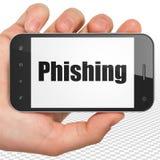 Veiligheidsconcept: Handholding Smartphone met Phishing op vertoning Stock Afbeelding