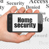 Veiligheidsconcept: Huisveiligheid op Handholding Royalty-vrije Stock Afbeeldingen