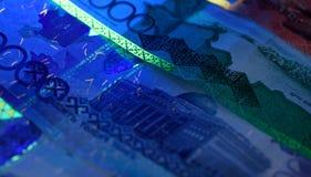 Veiligheidseigenschappen op bankbiljet in UVlichtbescherming Stock Foto's