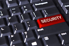 Veiligheidswoord op de rode knoop Stock Fotografie
