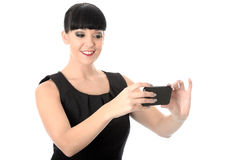 Vein Relaxed Happy Woman Taking A Self Portrait On Cell Phone. Vein relaxed happy Woman with straight black hair and hispanic or european features, looking away Stock Photo