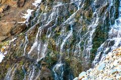 Veins of water falling down Tioga Pass. Water flowing down the path that leads to Mono Lake Stock Images