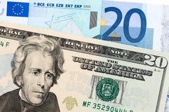 Veinte dólares contra el euro veinte Imágenes de archivo libres de regalías