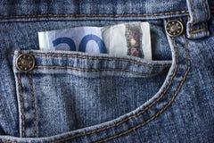 Veinte euros y un par de pantalones vaqueros Fotografía de archivo