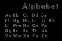 Vektor av den stiliserade polygonal stilsorten och alfabetet Royaltyfri Foto