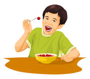 Vektor av pojken som äter druvor genom att använda gaffeln Arkivfoto