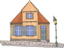 Vektor Ein gelbes Haus mit einem mit Ziegeln gedeckten Dach Stockfoto