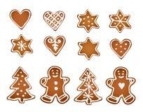vektor för illustration för julkakapepparkaka set Dekorativt pepparkakaman, stjärnor, hjärtor och julträd med isläggning på vit b stock illustrationer