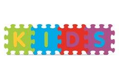 Vektor KINDER geschrieben mit Alphabetpuzzlespiel Stockfotos