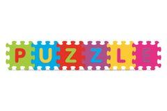 Vektor PUZZLESPIEL geschrieben mit Alphabetpuzzlespiel Stockbild