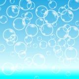 Vektorbubblor på blå bakgrund Arkivbild