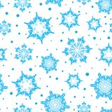 Vektorferieljus - blå hand drog christmasssnöflingor stock illustrationer