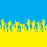 Vektorhand med den Ukraina flaggan Arkivfoton