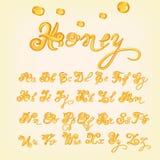 Vektorhonigalphabet Glänzende, glasig-glänzende Buchstaben, Flüssigkeit Gussart Glattes Maschinenschriftsatzdesign Lizenzfreies Stockfoto