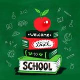 Vektorillustration av äpplet på böcker Royaltyfria Bilder