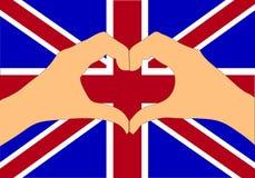 Vektorillustration av den Förenade kungariket flaggan och händer som gör en hjärta att forma Arkivbilder