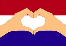 Vektorillustration av den Holland flaggan och händer som gör en hjärta att forma Arkivbild