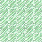 Vektorillustration av en grön modell med spirala stjärnor och cirklar på en vit bakgrund Royaltyfri Fotografi