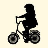 Vektorillustration av en kontur av lite flickan på en liten cykelhjälm Royaltyfri Foto