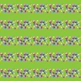 Vektorillustration av en sömlös bild av en sömlös modell av påskägg av olika färger i rader på en grön bakgrund Arkivfoto