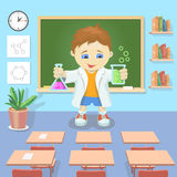 Vektorillustration av en ung pojke som studerar kemi i ett klassrum Royaltyfria Bilder