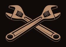 Vektorillustration av korsade skiftnycklar på en mörk bakgrund royaltyfri illustrationer