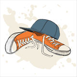 Vektorillustration med gymnastikskor och baseballmössan vektor illustrationer
