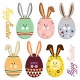 Vektorillustrationuppsättningen av färgrika ägg med kaninen vänder mot och gå i ax Royaltyfri Bild