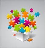 Vektorkasten voll bunte Puzzlespiele Lizenzfreie Stockfotos