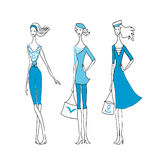 Vektorn för tre modekvinnor skissar av en samling för sommarhavsvind Royaltyfri Foto