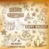 Vektorn skissade julsymboler stock illustrationer