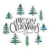 Vektortext för glad jul som är calligraphic med julgranar Royaltyfria Bilder