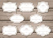 Vektoruppsättning av etiketter och etiketter med ramar Royaltyfri Fotografi