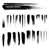 Vektoruppsättning av grungeborsteslaglängder Royaltyfri Bild