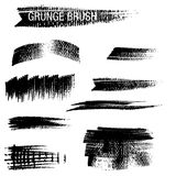 Vektoruppsättning av grungeborsteslaglängder Arkivbilder