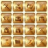 Vektoruppsättning av guld- fyrkantiga knappar Arkivfoto