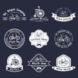 Vektoruppsättning av logoen för tappninghipstercykel Modern cykelemblem- eller emblemsamling Arkivfoto