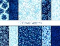 Vektoruppsättning av sömlösa modeller med blåa blommor Vektor Illustrationer