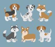 Vektoruppsättning med gulliga tecknad filmhundvalpar vektor illustrationer