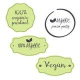 Vektoruppsättning organisk 100%, strikt vegetarian, högvärdiga symboler för kvalitets- produkt Fotografering för Bildbyråer