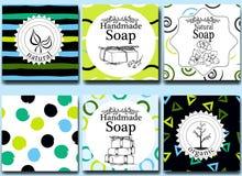 Vektoruppsättningen av sömlösa modeller, etiketter och logoen planlägger mallar för handgjord naturlig tvål som förpackar och inp Royaltyfria Foton