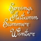 Vektoruppsättning av namn av säsonger av året, hand dragen bokstäver Arkivbild