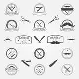 Vektoruppsättningen av barberaren shoppar logo Arkivbilder