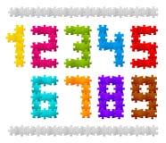 Vektorzahlen gebildet von den Puzzlespielstücken Stockfotos