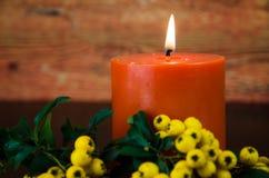 Vela anaranjada ardiente Imagenes de archivo
