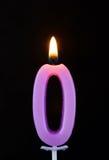 Vela ardente da cera como o número zero no preto Fotografia de Stock Royalty Free
