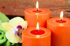 Vela ardiente anaranjada Foto de archivo libre de regalías